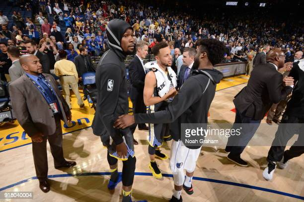 Stephen Curry Kevin Durant of the Golden State Warriors and Wesley Matthews of the Dallas Mavericks after the game on February 8 2018 at ORACLE Arena...