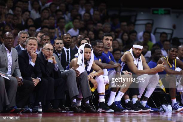Stephen Curry Kevin Durant Zaza Pachulia JaVale McGee and coach Steve Kerr of the Golden State Warriors react during the game between the Minnesota...