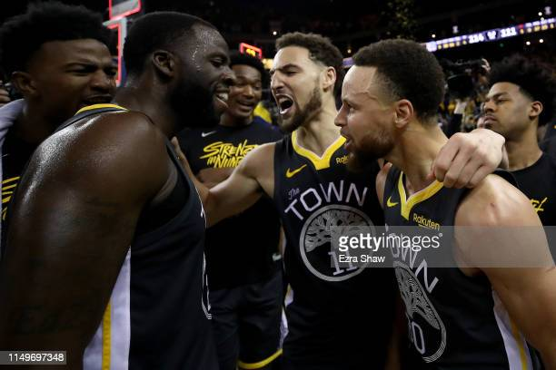 Stephen Curry, Klay Thompson and Draymond Green of the Golden State Warriors celebrate after defeating the Portland Trail Blazers 114-111 in game two...