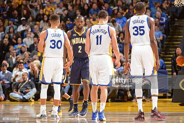Stephen Curry Klay Thompson and Kevin Durant of the Golden State Warriors walk up the court during the game against the Indiana Pacers on December 5...