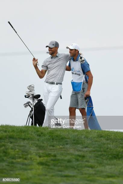 Stephen Curry laughs with his caddie Jonnie West on the eighth hole during round two of the Ellie Mae Classic at TCP Stonebrae on August 4 2017 in...
