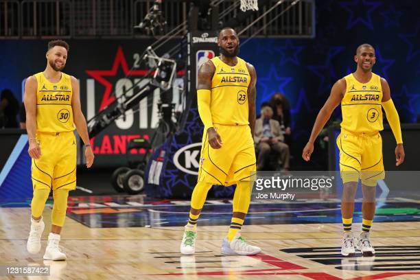 Stephen Curry, LeBron James and Chris Paul of Team LeBron smile and walk up court during the 70th NBA All Star Game as part of 2021 NBA All Star...