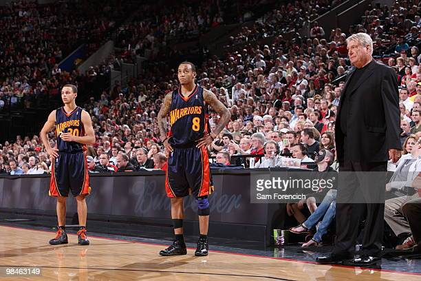 Stephen Curry Monta Ellis and coach Don Nelson of the Golden State Warriors wait out a technical foul shot during a game against the Portland Trail...