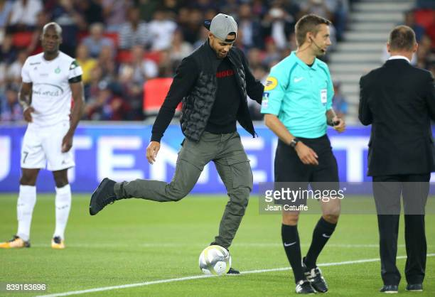 Stephen Curry of Golden State Warriors helps to kick off the French Ligue 1 match between Paris Saint Germain and AS SaintEtienne at Parc des Princes...