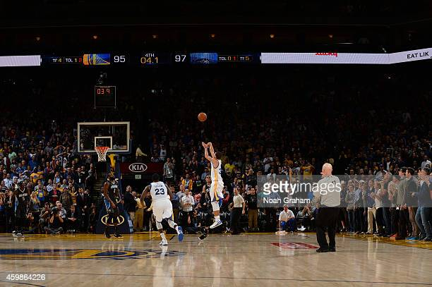 Stephen Curry of Golden State Warriors takes a shot as time runs down against the Orlando Magic on December 2 2014 at Oracle Arena in Oakland...