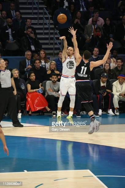 Stephen Curry of Team Giannis shoots against Klay Thompson of Team LeBron during the 2019 NBA AllStar Game on February 17 2019 at the Spectrum Center...