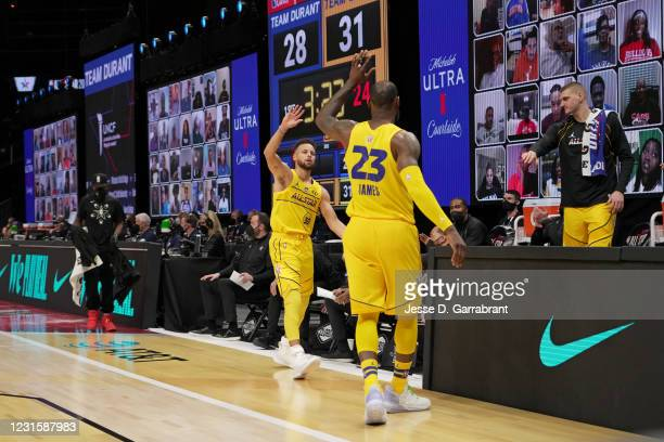 Stephen Curry of Team LeBron and LeBron James of Team LeBron high-five during the 70th NBA All Star Game as part of 2021 NBA All Star Weekend on...