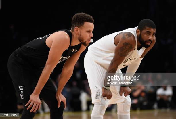 Stephen Curry of Team Stephen and Kyrie Irving of Team LeBron take a breath during the NBA AllStar Game 2018 at Staples Center on February 18 2018 in...