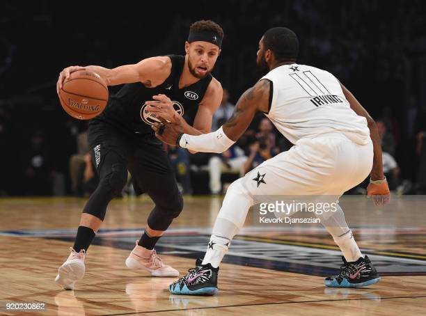Stephen Curry of Team Stephen drives on Kyrie Irving of Team LeBron during the NBA AllStar Game 2018 at Staples Center on February 18 2018 in Los...