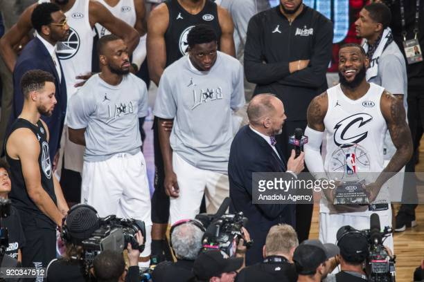 Stephen Curry of Team Stephen looks on as LeBron James of Team Lebron wins the MVP trophy after Team Lebron defeats Team Stephen during the 2018 NBA...