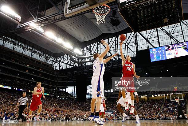 Stephen Curry of the Davidson Wildcats attempts a shot against Cole Aldrich of the Kansas Jayhawks during the Midwest Regional Final of the 2008 NCAA...