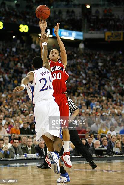Stephen Curry of the Davidson Wildcats attempts a shot against Brandon Rush of the Kansas Jayhawks during the Midwest Regional Final of the 2008 NCAA...