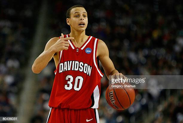 Stephen Curry of the Davidson Wildcats directs the offense against the Kansas Jayhawks during the Midwest Regional Final of the 2008 NCAA Division I...