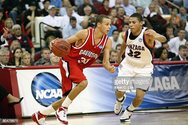 Stephen Curry of the Davidson Wildcats drives against Steven Gray of the Gonzaga Bulldogs during the 1st round of the 2008 NCAA Men's Basketball...