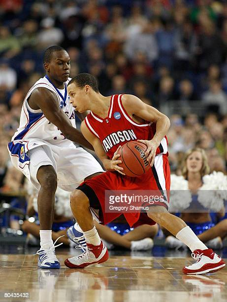 Stephen Curry of the Davidson Wildcats looks to drives against Russell Robinson of the Kansas Jayhawks during the Midwest Regional Final of the 2008...