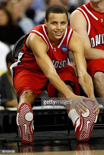 Stephen Curry of the Davidson Wildcats smiles as he stretches against the Kansas Jayhawks during the Midwest Regional Final of the 2008 NCAA Division...