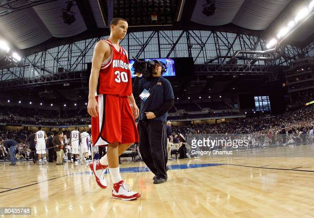 Stephen Curry of the Davidson Wildcats walks off the court after he lost 5957 against the Kansas Jayhawks during the Midwest Regional Final of the...