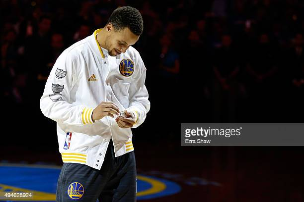 Stephen Curry of the Golden State Warriors admires his championship ring prior to their game against the New Orleans Pelicans in the NBA season...