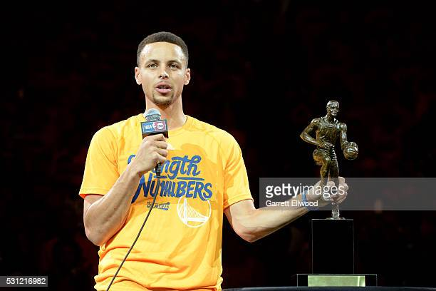 Stephen Curry of the Golden State Warriors adresses the fans after receiving the Maurice Podoloff MVP trophy before the game against the Portland...