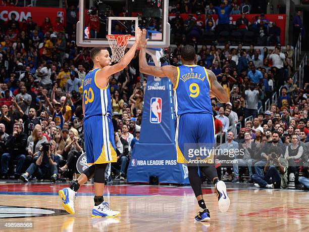 Stephen Curry of the Golden State Warriors and Andre Iguodala of the Golden State Warriors celebrate against the Los Angeles Clippers on November 19...