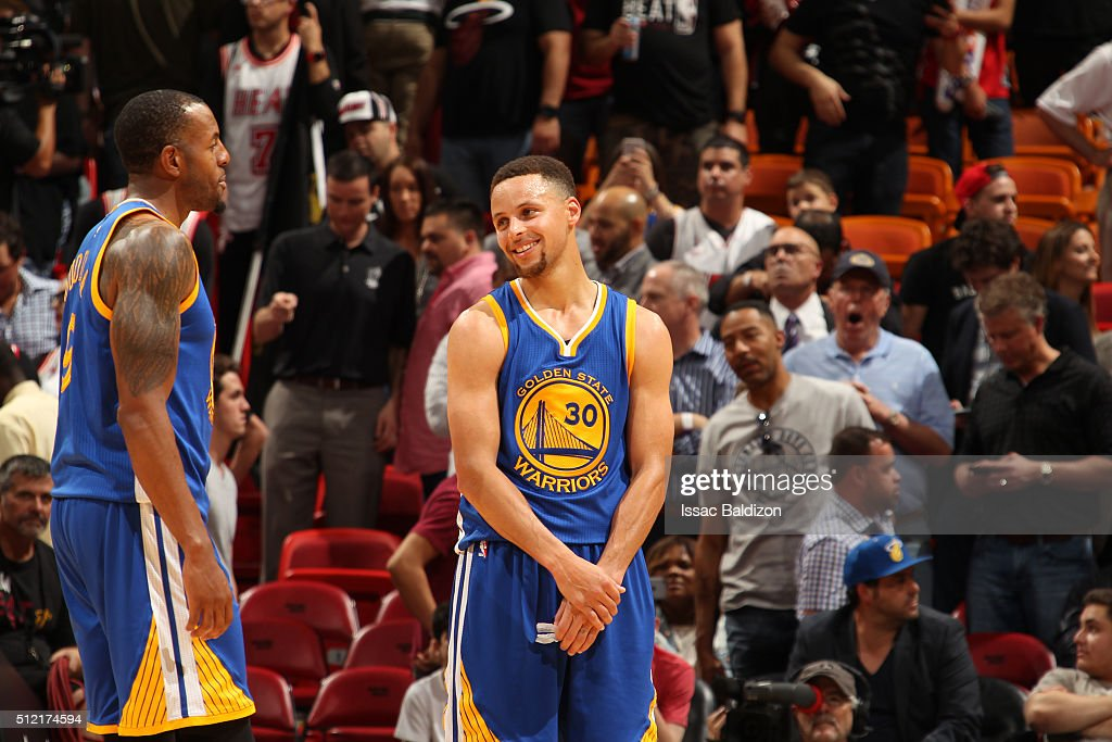 Stephen Curry #30 of the Golden State Warriors and Andre Iguodala #9 of the Golden State Warriors talk during the game against the Miami Heat on February 24, 2016 at American Airlines Arena in Miami, Florida.