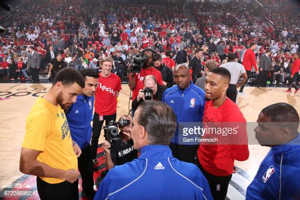 Stephen Curry of the Golden State Warriors and Damian Lillard of the Portland Trail Blazers talk to the officials before Game Three of the Western...
