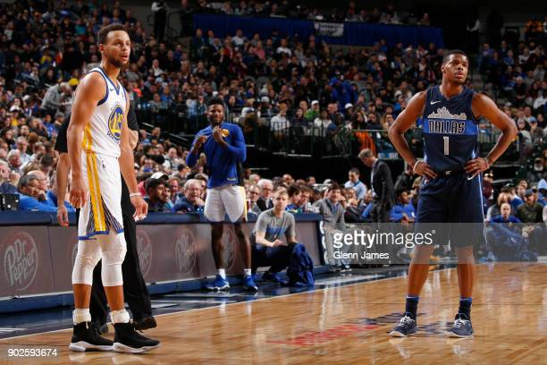 Stephen Curry of the Golden State Warriors and Dennis Smith Jr #1 of the Dallas Mavericks stand on the court during the game on January 3 2018 at the...