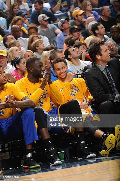 Stephen Curry of the Golden State Warriors and Draymond Green of the Golden State Warriors sit on the bench against the Memphis Grizzlies in Game Six...