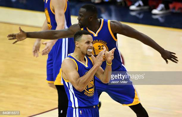Stephen Curry of the Golden State Warriors and Draymond Green react during the first half against the Cleveland Cavaliers in Game 6 of the 2016 NBA...