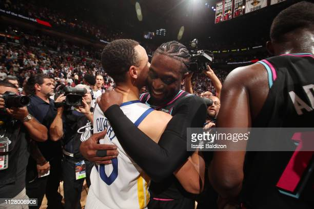 Stephen Curry of the Golden State Warriors and Dwyane Wade of the Miami Heat hug after a game on February 27 2019 at American Airlines Arena in Miami...
