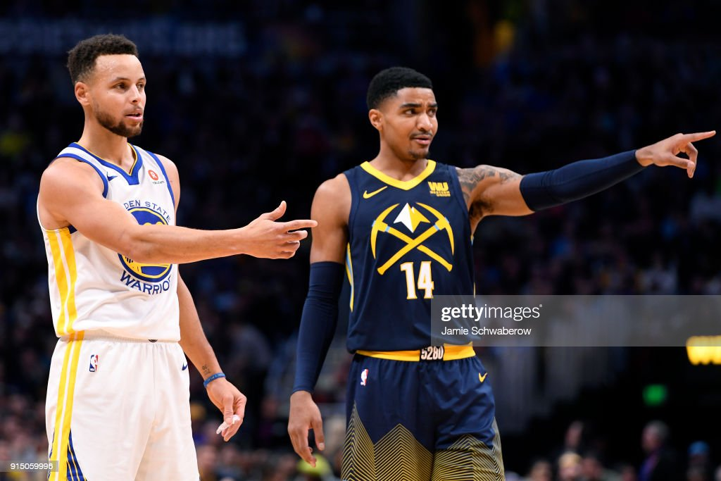 Stephen Curry #30 of the Golden State Warriors and Gary Harris #14 of the Denver Nuggets react to a foul at Pepsi Center on February 3, 2018 in Denver, Colorado.