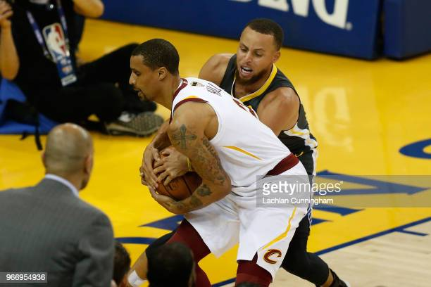Stephen Curry of the Golden State Warriors and George Hill of the Cleveland Cavaliers battle for posession of the ball during the first half in Game...