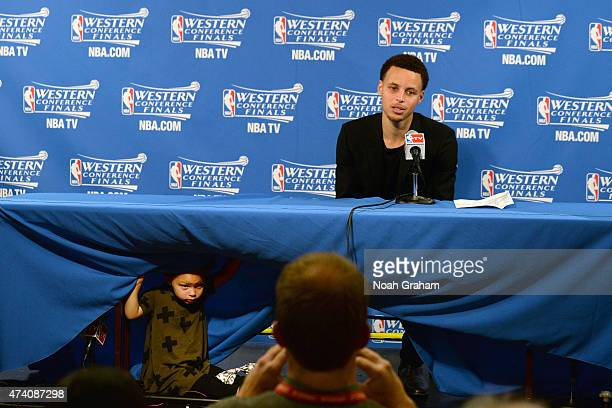 Stephen Curry of the Golden State Warriors and his daughter Riley talking with the media at a press conference after the game against the Houston...