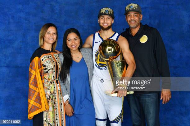 Stephen Curry of the Golden State Warriors and his family pose for a portrait with the Larry O'Brien Championship trophy after defeating the...