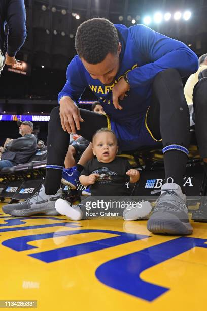 Stephen Curry of the Golden State Warriors and his son Canon Jack Curry pose for a photo before the game against the Charlotte Hornets on March 31...