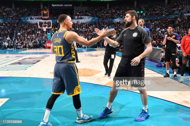 Stephen Curry of the Golden State Warriors and Joe Harris of the Brooklyn Nets high five during the 2019 Mtn Dew 3Point Contest as part of the State...