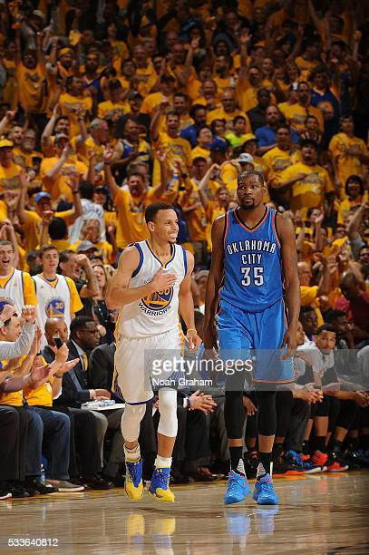 Stephen Curry of the Golden State Warriors and Kevin Durant of the Oklahoma City Thunder looks on during the game in Game Two of the Western...