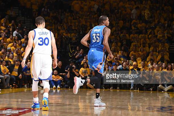 Stephen Curry of the Golden State Warriors and Kevin Durant of the Oklahoma City Thunder run up court after a plau during Game Seven of the Western...