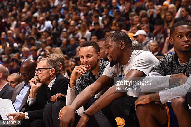 Stephen Curry of the Golden State Warriors and Kevin Durant of the Golden State Warriors talk on the bench during the game against the Toronto...