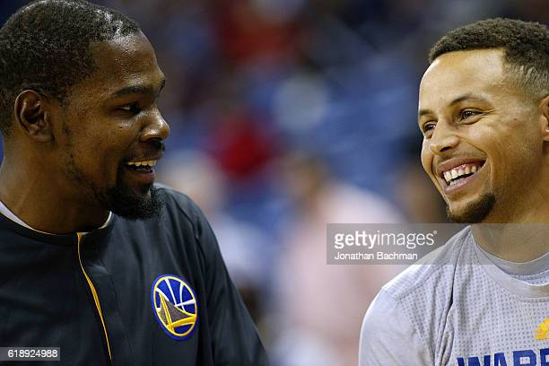 Stephen Curry of the Golden State Warriors and Kevin Durant of the Golden State Warriors warm up before a game against the New Orleans Pelicans at...
