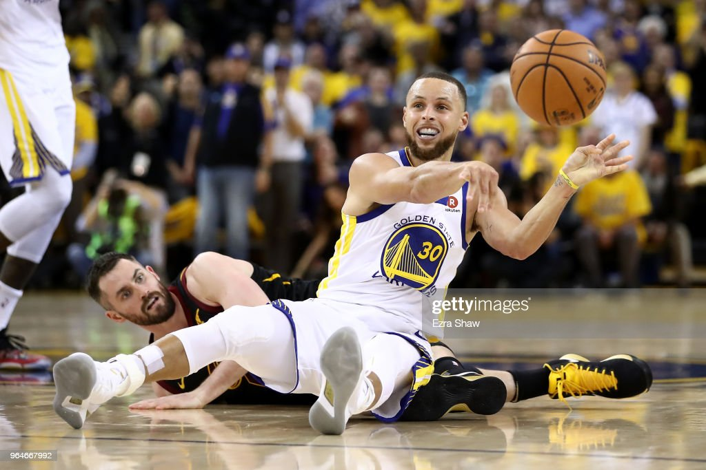 Stephen Curry #30 of the Golden State Warriors and Kevin Love #0 of the Cleveland Cavaliers go for a loose ball in Game 1 of the 2018 NBA Finals at ORACLE Arena on May 31, 2018 in Oakland, California.