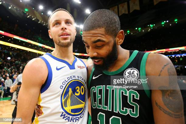 Stephen Curry of the Golden State Warriors and Kyrie Irving of the Boston Celtics embrace after a game at TD Garden on January 26 2019 in Boston...