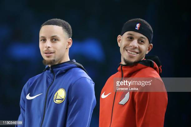 Stephen Curry of the Golden State Warriors and Seth Curry of the Portland Trail Blazers look on before the MTN DEW 3Point Contest as part of the 2019...