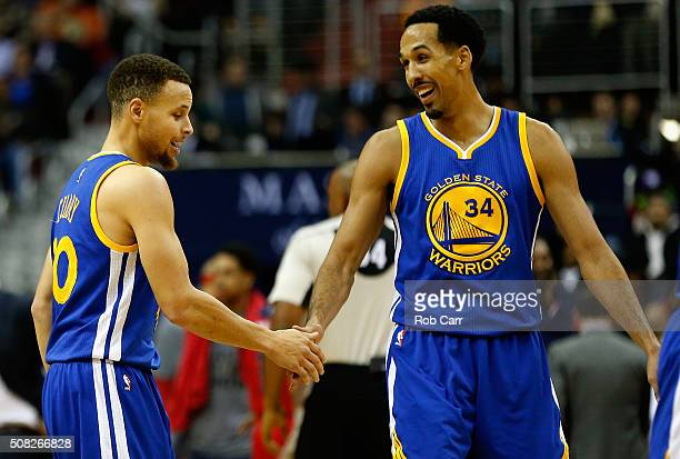 Stephen Curry of the Golden State Warriors and Shaun Livingston celebrate during a second half time out against the Washington Wizards at Verizon...