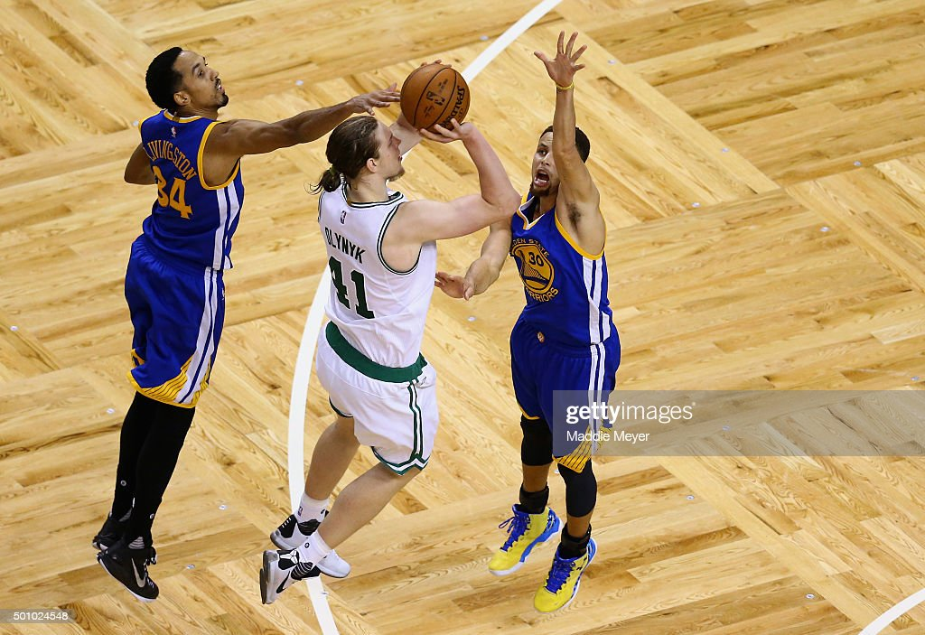Stephen Curry #30 of the Golden State Warriors and Shaun Livingston #34 defend Kelly Olynyk #41 of the Boston Celtics during the fourth quarter at TD Garden on December 11, 2015 in Boston, Massachusetts. The Warriors defeat the Celtics 124-119.