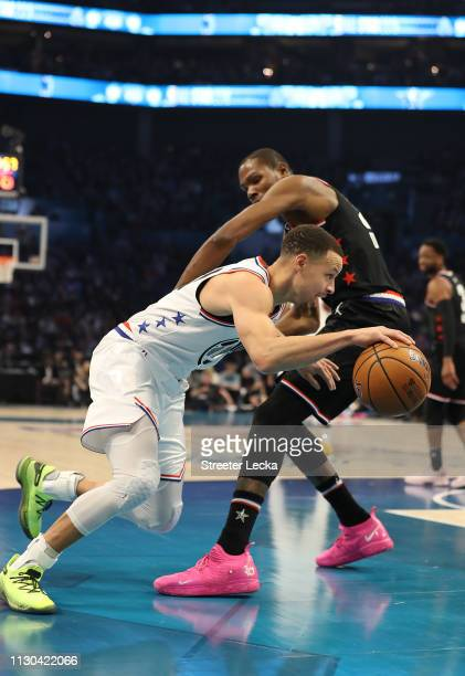 Stephen Curry of the Golden State Warriors and Team Giannis drives against Kevin Durant of the Golden State Warriors and Team LeBron in the third...