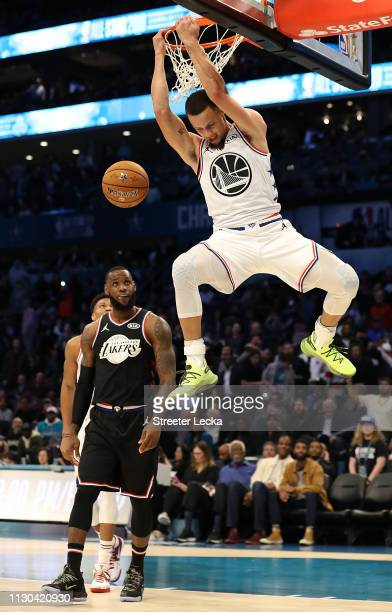 Stephen Curry of the Golden State Warriors and Team Giannis dunks against Team LeBron in the fourth quarter during the NBA AllStar game as part of...