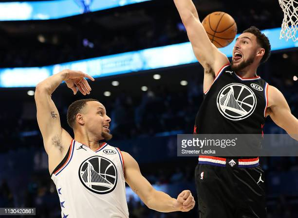 Stephen Curry of the Golden State Warriors and Team Giannis passes around Klay Thompson of the Golden State Warriors and Team LeBron in the fourth...