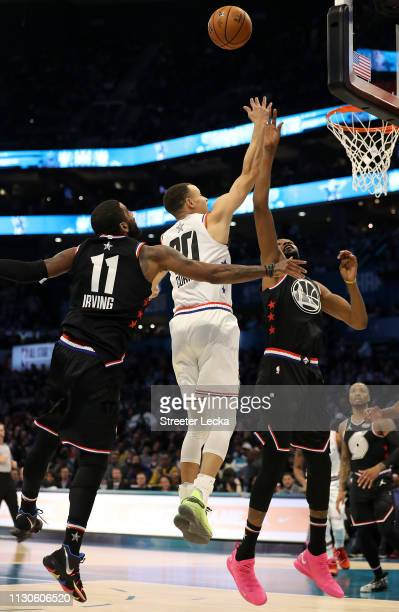 Stephen Curry of the Golden State Warriors and Team Giannis shoots against Kyrie Irving of the Boston Celtics and Kevin Durant of the Golden State...