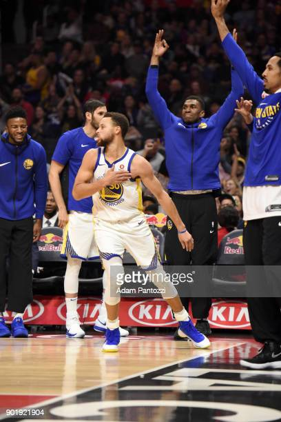 Stephen Curry of the Golden State Warriors and the bench celebrate during the game against the LA Clippers on January 6 2018 at STAPLES Center in Los...
